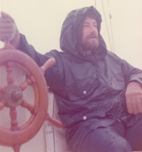 Larry Edwards at the helm of the Spellbound, 1977